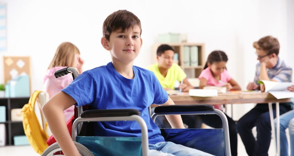 boy in wheelchair in classroom