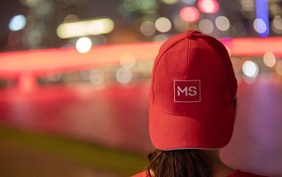 Supporter wearing MS Queensland cap